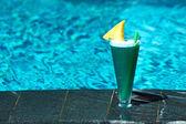 Cocktail near pool — Stock Photo
