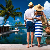 Couple near poolside — Stock Photo