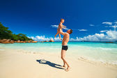 Father and   boy  on beach — Stock Photo
