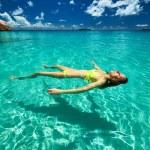 Woman in bikini lying on water — Stock Photo