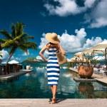 Woman sailor striped in dress near poolside — Stock Photo
