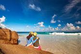 Couple at tropical beach wearing rash guard — Stock Photo