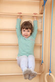 Little girl climbing — Stock Photo