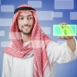 Young arab pressing virtual buttons — Stock Photo #11399780