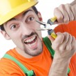 Repairman in coveralls in industrial concept — Stock Photo #11399866