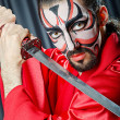 Man with face mask and sword — Stock Photo #12323674