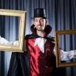 Magician with photoframe in studio - Foto Stock