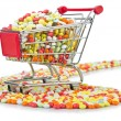 Shopping cart with many colourful pills - Photo