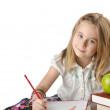 Little girl writing with pencils — Stock Photo