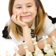 Royalty-Free Stock Photo: Cute girl playing chess on white