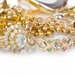 Lots of jewellery on white — Stock Photo #12544390