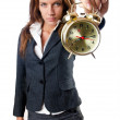 Businesswoman with alarm clock on white — Stock Photo #12545202