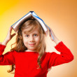 Little girl with books on white — Stock Photo #12545687