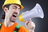 Construction worker with loudspeaker in studio — Stock Photo
