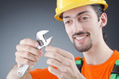 Man with a wrench in a studio — Stock Photo