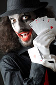Joker with cards in studio shoot — Stock Photo