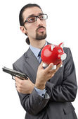 Businessman killing the piggy bank — Стоковое фото