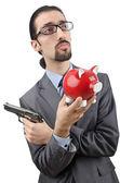 Uomo d'affari uccidendo il porcellino salvadanaio — Foto Stock