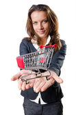 Attractive businesswoman with shopping cart — Stock Photo