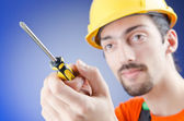 Man with a screwdriver in studio — Stock Photo