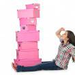 Girl with stack of giftboxes — Stock Photo