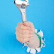 Stock Photo: Hand holding chrome wrenh