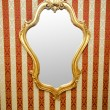 Ornate mirror on the wall — Stock Photo