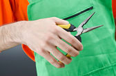 Man with tongs in studio — Stock Photo