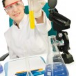 Female chemist in studio on white — Stock Photo