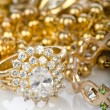Lots of jewellery on white - Stock Photo