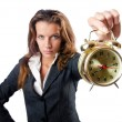 Businesswoman with alarm clock on white — Stock Photo #12650940