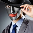 Businessman with clown face paint — Stock Photo #12651231