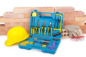Construction concept with helmet and toolkit — Stockfoto