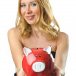 Woman with piggybank on white - Photo