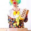 Bad construction concept with clown laying bricks — Photo