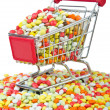 Shopping cart with many colourful pills — Stock Photo