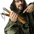 Funny soldier with nunchaku — Stock Photo #12846501