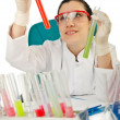 Female chemist in studio on white - Stock Photo