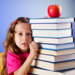 Little girl with books on white — Stock Photo