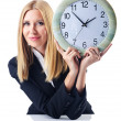 Stock Photo: Businesswomwith clock isolated on white