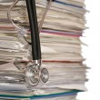 Stack of papers with stethoscope - Stock fotografie