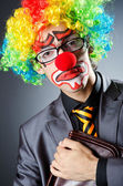 Businessman with clown wig and face paint — Stock Photo