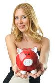 Woman with piggybank on white — Stock Photo