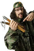 Funny soldier with nunchaku — Stock Photo