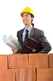 Businessman near brick wall — Stock Photo