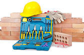 Construction concept with helmet and toolkit — Photo