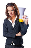 Businesswoman with loudspeaker on white — Stock Photo