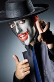 Businessman with clown face paint — Stock Photo