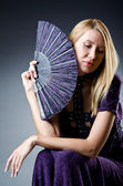 Beautiful woman with japanese fan — Stock Photo