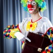 Clown with business briefcase — Stock Photo